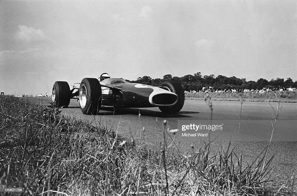 Scottish racing driver Jim Clark (1936 - 1968) on his way to victory in a Lotus-Cosworth 49 during the British Grand Prix at Silverstone, 15th July 1967.