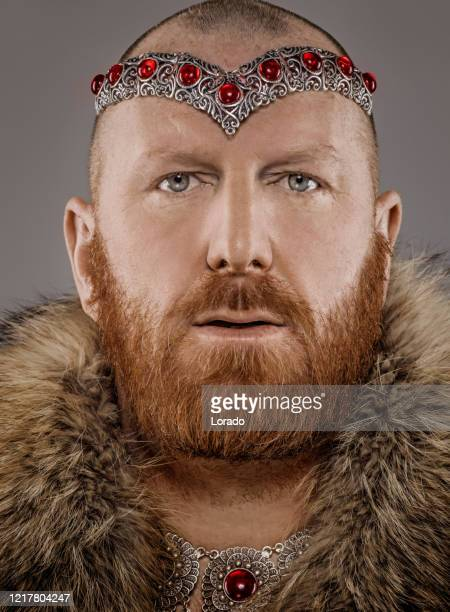 scottish redhead warrior wearing a crown - northern european stock pictures, royalty-free photos & images