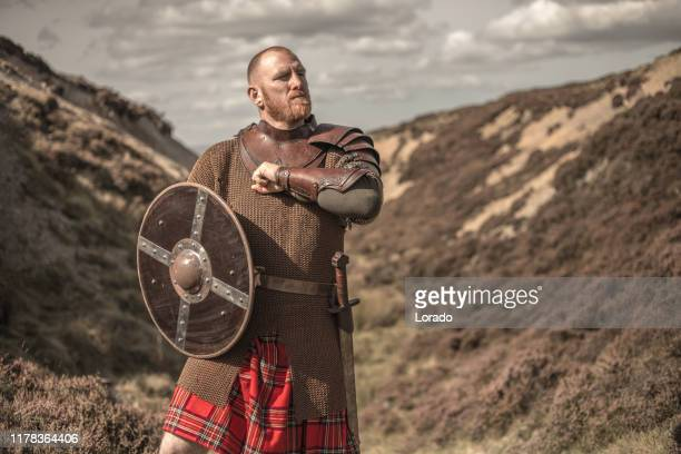 scottish redhead warrior wearing a kilt - historical clothing stock pictures, royalty-free photos & images