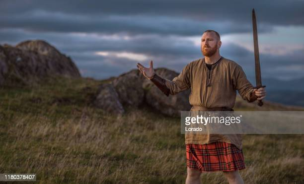 scottish redhead warrior wearing a kilt - golf tournament stock pictures, royalty-free photos & images