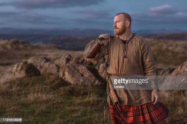 scottish redhead warrior wearing a kilt - scotland imagens e fotografias de stock