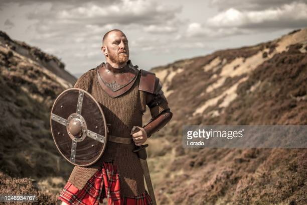 scottish redhead warrior wearing a kilt - historical reenactment stock pictures, royalty-free photos & images