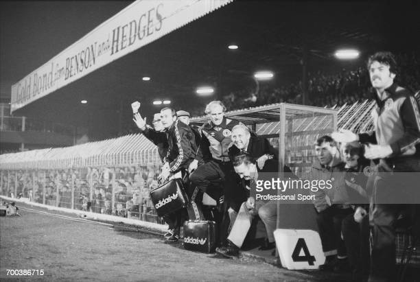 Scottish retired footballer and manager of Scotland Jock Stein rises from the bench with members of his management team and substitute John Wark in...