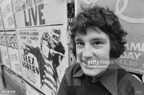 Scottish rock and blues musician Alex Harvey with a poster of one of his concerts at the London Palladium London UK 28th February 1978