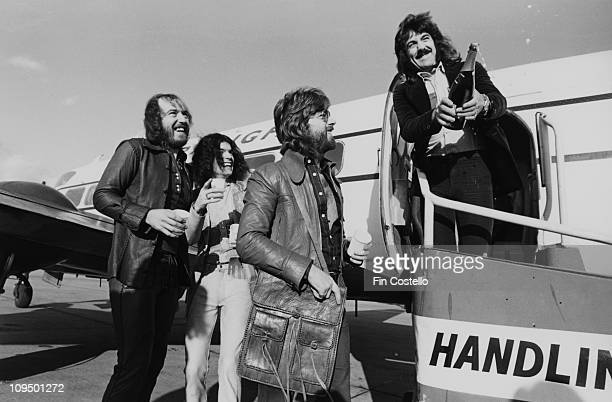 Scottish rock group Nazareth at an airport at the start of their British tour 17th October 1973 Left to right bassist Pete Agnew singer Dan...