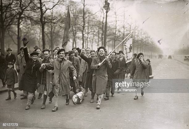 Scottish rugby fans arriving in London for the international game between England and Scotland at Twickenham Stadium, 17th March 1934. They are...