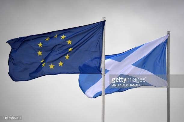 Scottish Saltire flag flies alongside a European Union flag at The Solheim Cup golf tournament at the Gleneagles Hotel in Gleneagles, Scotland, on...