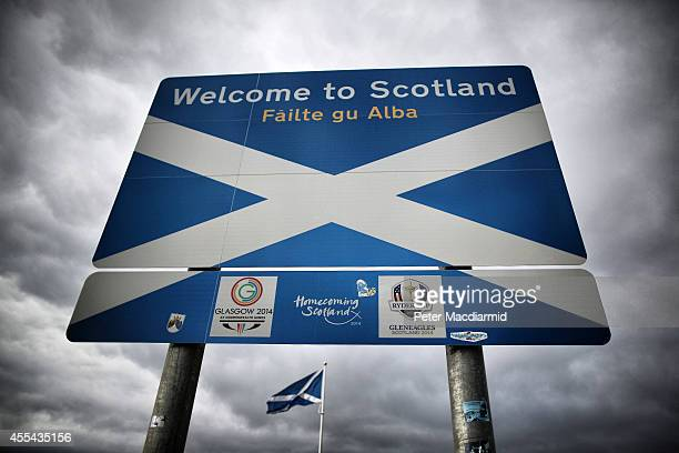 A Scottish Saltire flag flies on the border with England on September 14 2014 in Carter Bar Scotland The latest polls in Scotland's independence...