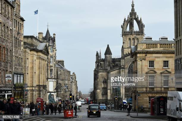 A Scottish Saltire flies from a pole atop a row of buildings on the Royal Mile in Edinburgh on March 13 2017 Scotland's announcement on Monday that...