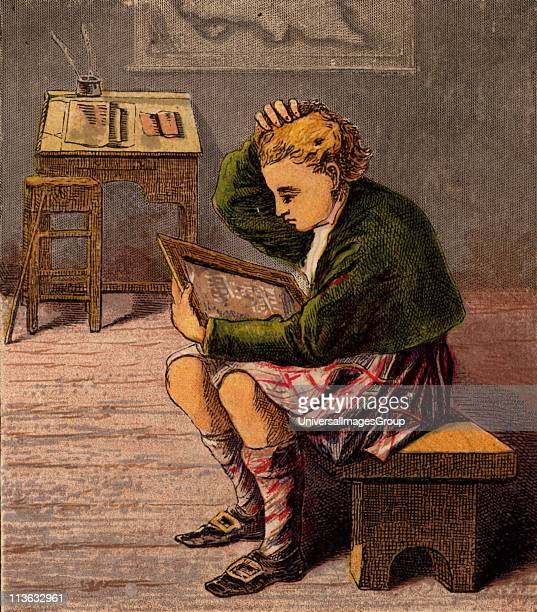 Scottish schoolboy dressed in a kilt and woollen threequarter hose puzzling over the writing on his slate Slate and chalk were widespread writing...