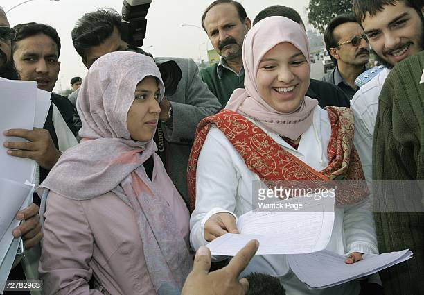 Scottish schoolgirl Misbah Rana hands out copies of her birth certificate to journalists outside Parliament House on December 9 2006 in Islamabad...