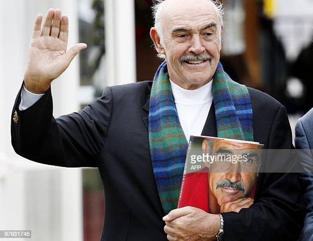 Scottish screen legend Sir Sean Connery poses for photographers as he promotes his new book called 'Being a Scot' at the Edinburgh International Book...
