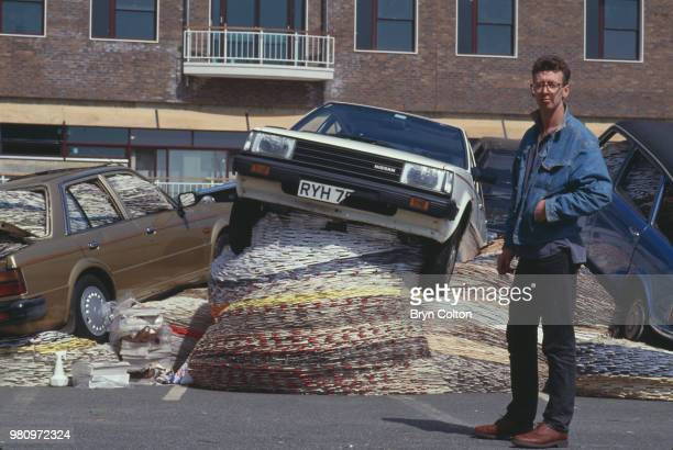 Scottish sculptor and installation artist David Mach next to his art installation titled 'MultiStorey Car Park' on display at the BBC Television...