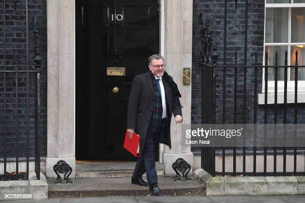 Scottish Secretary David Mundell leaves Number 10 after government ministers attended the first Cabinet meeting of the year at 10 Downing Street on...
