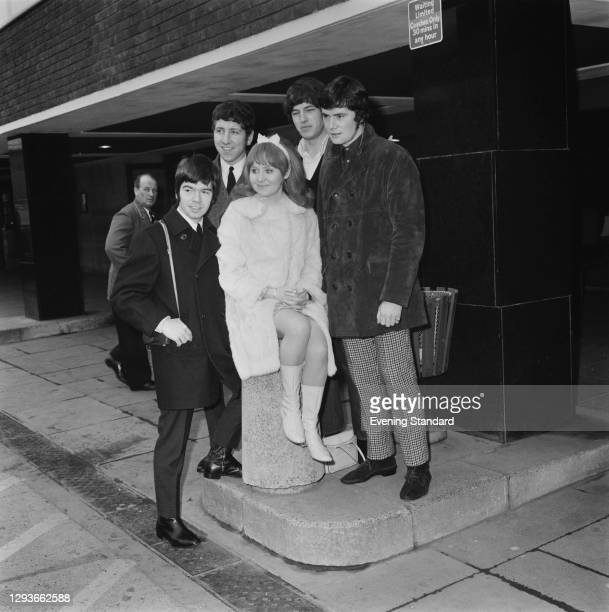 Scottish singer and actress Lulu with her backing group The Luvvers at London Airport, UK, 7th March 1966. From left to right, the Luvvers are Tommy...
