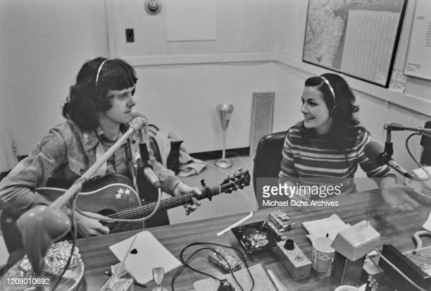 Scottish singer and musician Donovan with broadcaster Joanne Ginsberg on 'The Joanne Ginsberg Show' on WMCA Radio in New York City, October 1971.