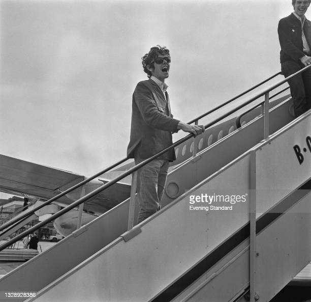 Scottish singer and songwriter and guitarist Donovan at London Airport , UK, 26th July 1965.
