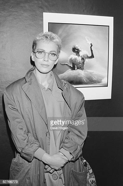 Scottish singer Annie Lennox of the Eurythmics with a photograph of herself in ballet costume circa 1985