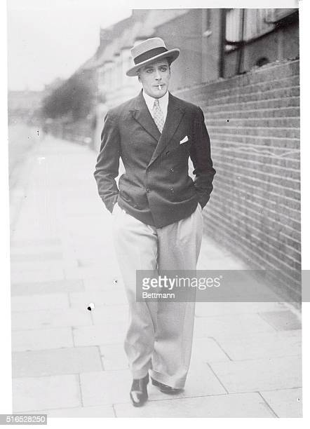 Scottish singer dancer actor producer and director Jack Buchanan 1891 1957 walking down a street circa 1925 He is wearing Oxford bags a style of...