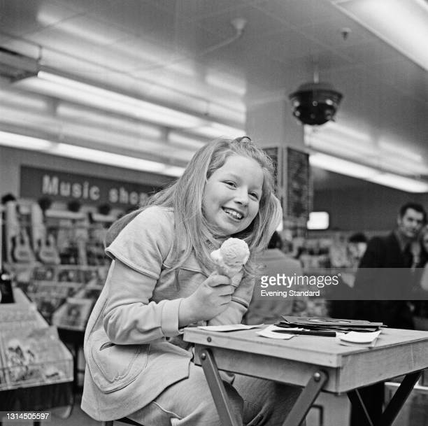 Scottish singer Lena Zavaroni eating an ice cream, UK, 21st January 1974. She had appeared on the television talent show 'Opportunity Knocks' earlier...