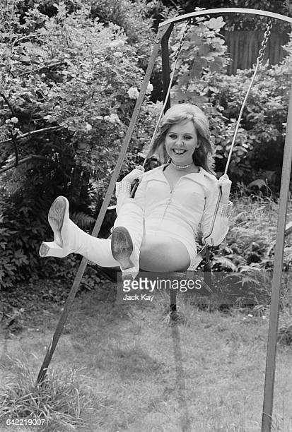 Scottish singer Lulu in hot pants on a swing UK prior to her departure for Las Vegas 3rd June 1971