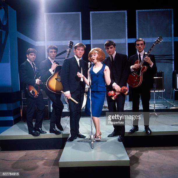 Scottish singer Lulu performs on a television show with her backing group The Luvvers in 1964 From left to right Tommy Tierney James Dewar David...