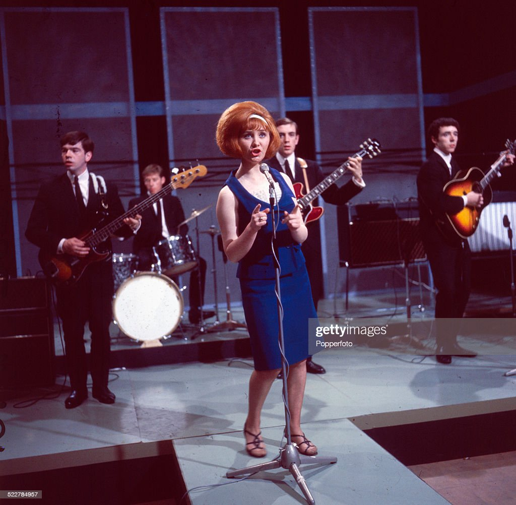 Scottish singer Lulu performs on a television show with her backing group The Luvvers in 1964. From left to right: Tommy Tierney, David Mullin, Lulu, Ross Neilson and James Dewar.