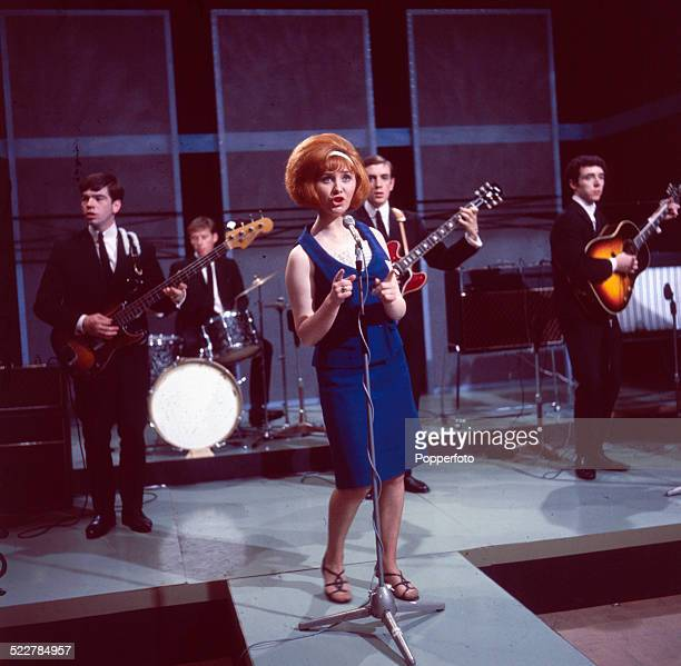 Scottish singer Lulu performs on a television show with her backing group The Luvvers in 1964 From left to right Tommy Tierney David Mullin Lulu Ross...