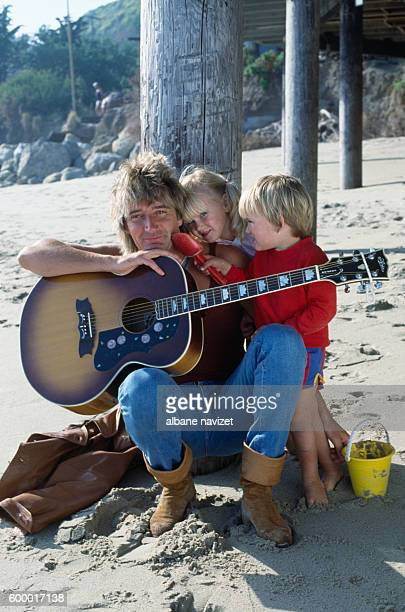 Scottish singer Rod Stewart relaxes with his children Kimberly and Sean.