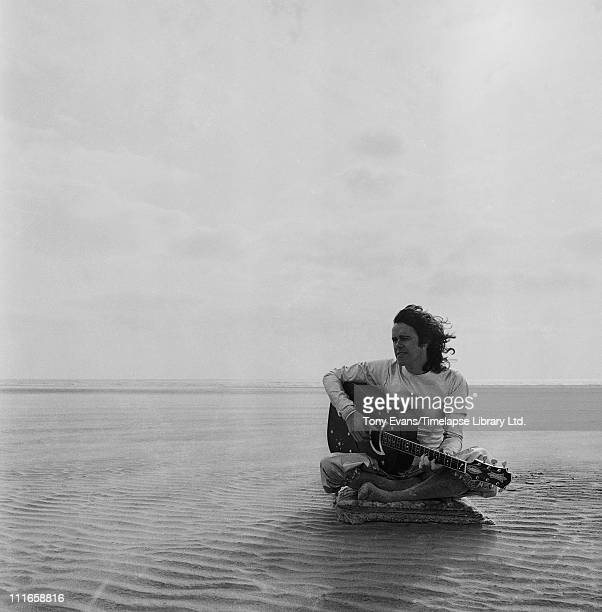 Scottish singer songwriter and guitarist Donovan Leitch 1972 A photoshoot at Camber Sands in East Sussex for the cover of his 1973 album 'Cosmic...