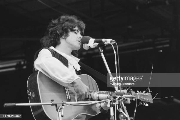 Scottish singer, songwriter and guitarist Donovan performs an acoustic set live on stage at the Isle of Wight Festival 1970 on 30th August 1970.