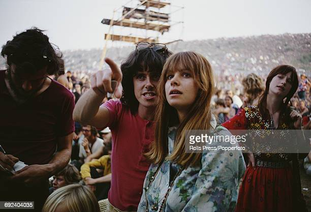 Scottish singer songwriter and guitarist Donovan pictured with a young woman in front of the stage at the Isle of Wight Festival 1970 in August 1970...