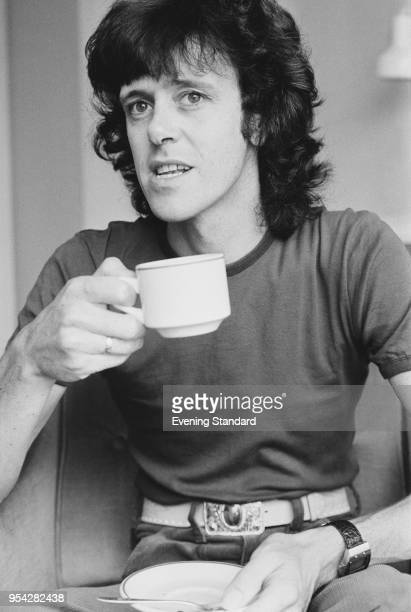Scottish singersongwriter and guitarist Donovan having a cup of tea UK 31st October 1977