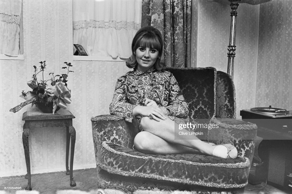 Scottish singer-songwriter and television personality Lulu sitting on a patterned armchair, UK, 29th July 1967.