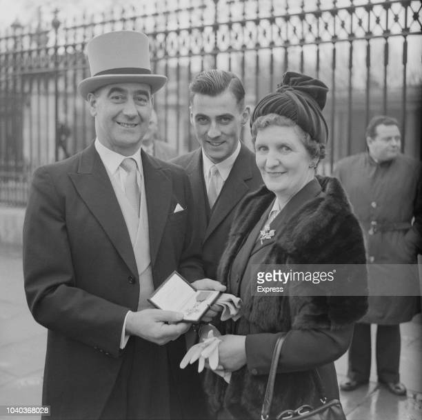 Scottish soccer player Tommy Walker with his family and his OBE medal outside Buckingham Palace London UK 22nd November 1960