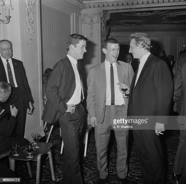 Scottish soccer players Denis Law Bobby Lennox and Jim McCalliog at an after match reception UK 17th April 1967