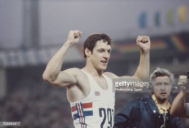 Scottish sprint athlete Allan Wells of the Great Britain team celebrates after crossing the finish line in first place to win the gold medal in the...