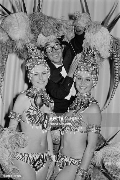 Scottish stand-up comedian, actor, writer, and broadcaster Ronnie Corbett with two cabaret dancers at the London's Savoy Hotel, UK, 20th November...