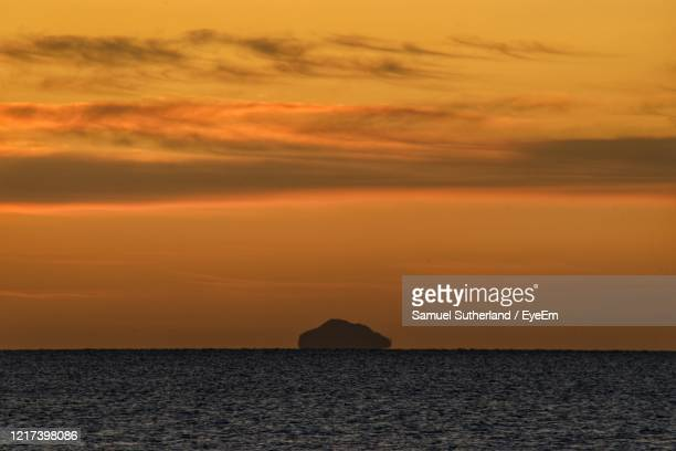 scottish sunrise - in silhouette stock pictures, royalty-free photos & images