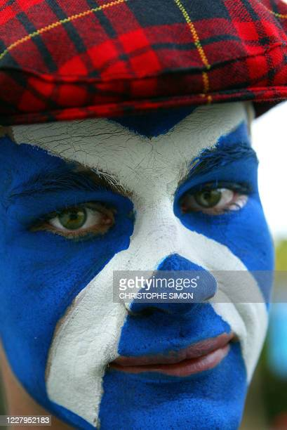 A Scottish supporter with a painted face arrives for the quarterfinal Rugby World Cup 2003 match between Australia and Scotland at the Suncorp...