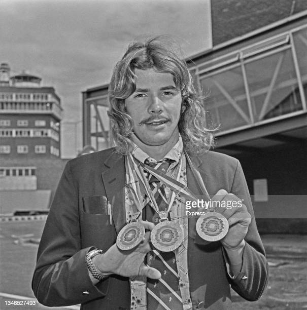 Scottish swimmer David Wilkie at Heathrow Airport in London with the three medals he won at the 13th European Aquatics Championships in Vienna,...