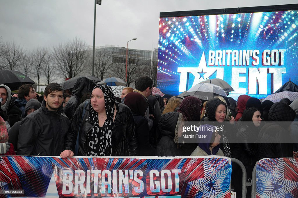 Scottish talent hopefuls with their families and members of the audience arrive at the very wet Glasgow auditions for Britain's Got Talent at Clyde Theatre on January 28, 2013 in Glasgow, Scotland.