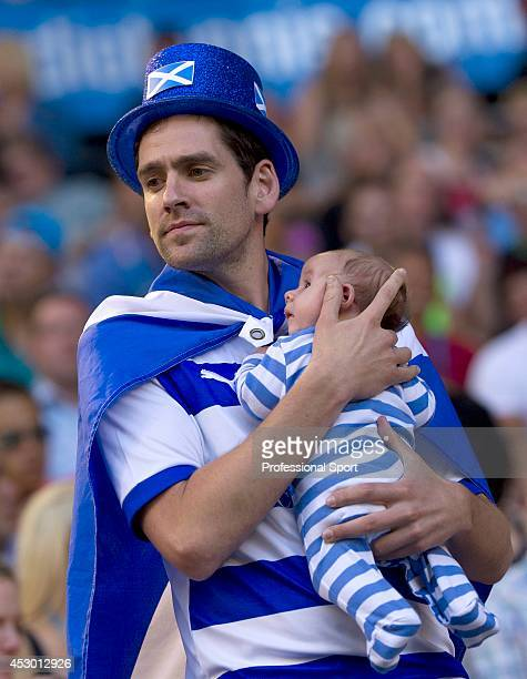 Scottish tennis fan and his baby attending the Men's Singles Final between Andy Murray of Great Britain and Novak Djokovic of Serbia during day...