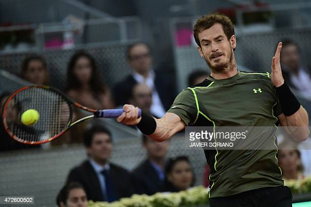 Scottish tennis player Andy Murray returns a ball to Canadian tennis player Milos Raonic during the men quarterfinals of Madrid Open tournament at...