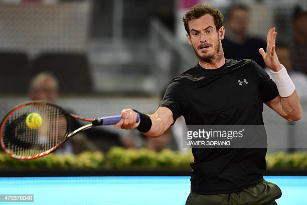Scottish tennis player Andy Murray returns a ball to German tennis player Philipp Kohlschreiber during the Madrid Open tournament at the Caja Magica...