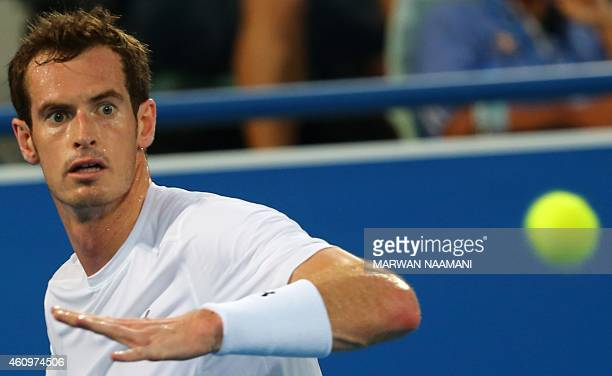Scottish tennis player Andy Murray returns the ball to Spanish player Rafael Nadal during their semifinal tennis match in the Mubadala World Tennis...