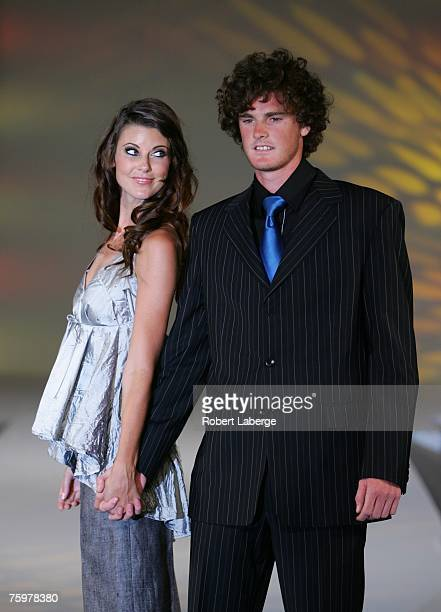 Scottish tennis player Jamie Murray and a model walk down the runway at the ATP Tennis fashion show part of the Rogers Cup Tennis Tournament at the...
