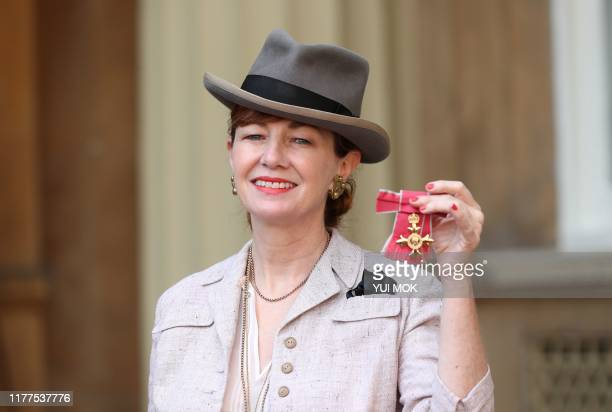 Scottish theatre set designer Bunny Christie poses with her medal after being appointed an Officer of the Order of the British Empire following an...