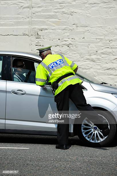 Scottish traffic police officer talking to a car driver