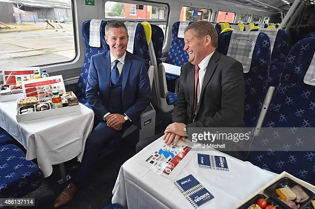 Scottish Transport Minister Derek Mackay and ScotrRail Alliance managing director Phil Verster unveil the first of 40 new look trains in a £14...
